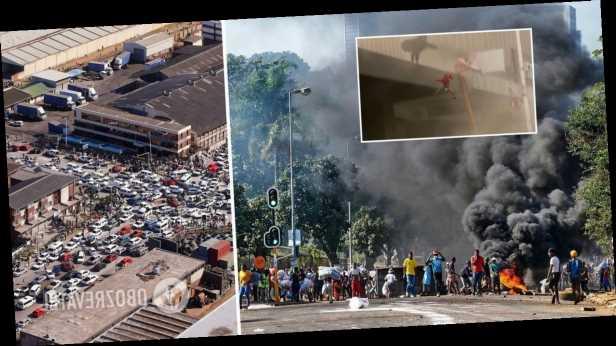 В охваченной беспорядками ЮАР женщина выбросила ребенка из горящего здания. Видео